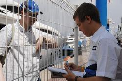 Sebastian Vettel, Test Driver, BMW Sauber F1 Team, gives autographs