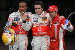 Pole winner Fernando Alonso celebrates with Lewis Hamilton and Felipe Massa