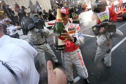 Lewis Hamilton sprays champagne