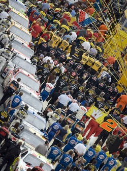 Crews line up for the National Anthem before the Autism Speaks 400