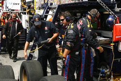Brian Vickers team Red Bull crew checks the tires that just came off his car after a pit stop