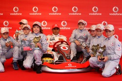 Lewis Hamilton, McLaren Mercedes, with young karters, Vodafone Karting Event