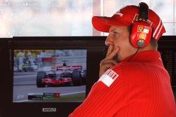 Michael Schumacher, Scuderia Ferrari, Advisor and Lewis Hamilton, McLaren Mercedes on the TV monitors