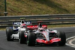Fernando Alonso, McLaren Mercedes, MP4-22 and Robert Kubica, BMW Sauber F1 Team, F1.07