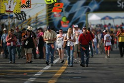 Fans walk the pitlane early in the morning