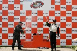 Podium: Kerry Micks and Trevor Seibert spray champagne