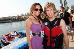 Sebastian Vettel, Scuderia Toro Rosso at the  Red Bull Aqua Battle with a girl