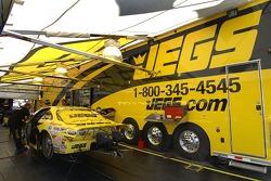 Crew works on Jeg Coughlin Jr's. car Friday morning