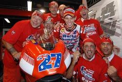 2007 MotoGP champion Casey Stoner celebrates with his team