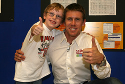 Carl Edwards poses with 5 year old Mitchell McGarry, at the Office Depot back pack give away at the loacl Store in Kansas City, MO.