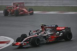 Sebastian Vettel, Scuderia Toro Rosso, STR02 clashes with Fernando Alonso, McLaren Mercedes, MP4-22