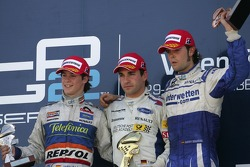 Timo Glock celebrates winning the 2007 GP2 Series title on the podium with Javier Villa and Andy Soucek
