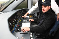 Tomas Enge, driver of A1 Team Czech Republic in the driving seat of the train