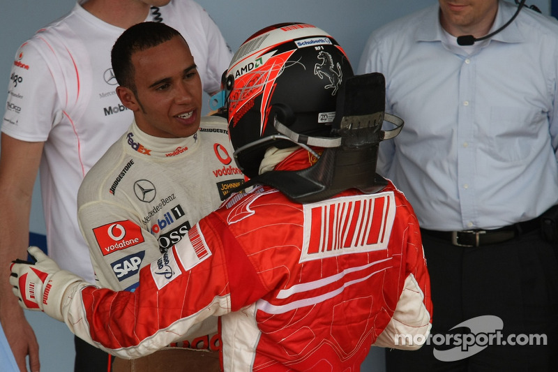 Race winner and 2007 World Champion Kimi Raikkonen congratulated by Lewis Hamilton