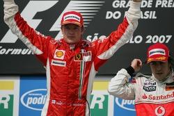 Podium: race winner and 2007 World Champion Kimi Raikkonen and third place Fernando Alonso