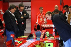 Tony Teixeira of A1GP, Richard Dorfman of A1GP and Emerson Fittipaldi, Seat Holder of A1 Team Brazil take a look at a Ferrari F1 car