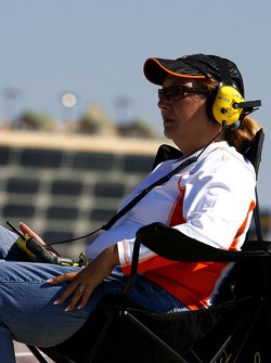 A race fan watches the Pep Boys Auto 500 on her fan view