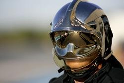 Giedo Van Der Garde (NED) (DAMS) is reflected in a fireman's helmet