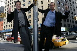 Jimmie Johnson, the 2007 NASCAR Nextel Cup Series Champion and his crew chief Chad Knaus hang onto a light post at the corner of 48th & 2nd  avenue, signifying their second consecutive championship in the #48 car
