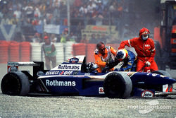 Marshalls stop Michael Schumacher getting to Damon Hill after their accident