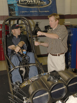 Robert Hight, in cockpit, gives physical therapist Robert Ortmayer a quick primer on driving a Funn