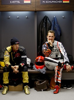 Sebastian Vettel and Michael Schumacher in the drivers briefing
