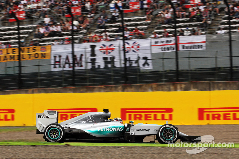 Lewis Hamilton, Mercedes AMG F1 W06 passes banners of support