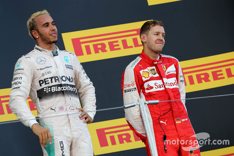 Race winner Lewis Hamilton, Mercedes AMG F1 Team and third place Sebastian Vettel, Ferrari