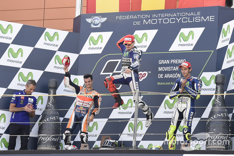 Podium: second place Dani Pedrosa, Repsol Honda Team and winner Jorge Lorenzo and third place Valent