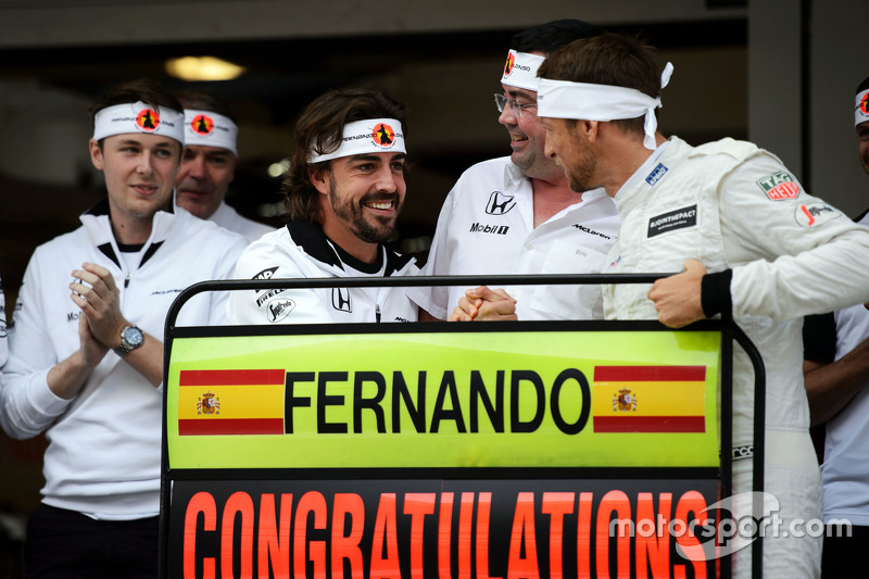 Jenson Button, McLaren,  celebrates the 250th GP for team mate Fernando Alonso, McLaren,