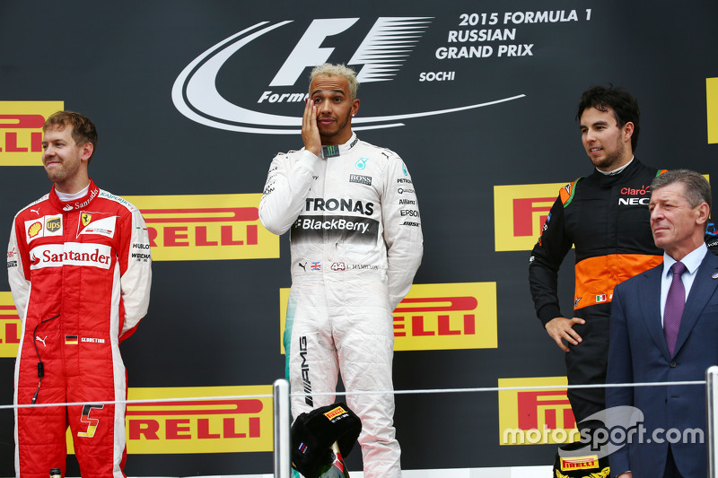 The podium,: Sebastian Vettel, Ferrari, second; Lewis Hamilton, Mercedes AMG F1, race winner; Sergio Perez, Sahara Force India F1, third