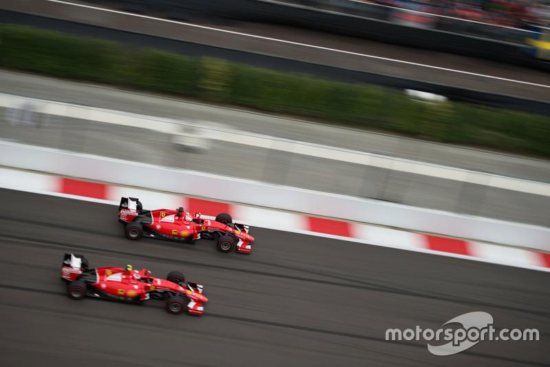 Sebastian Vettel, Ferrari SF15-T and team mate Kimi Raikkonen, Ferrari SF15-T battle for position