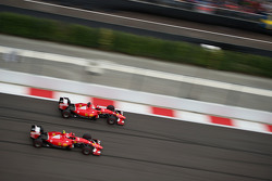 Sebastian Vettel, Ferrari SF15-T and team mate Kimi Raikkonen, Ferrari SF15-T battle for position