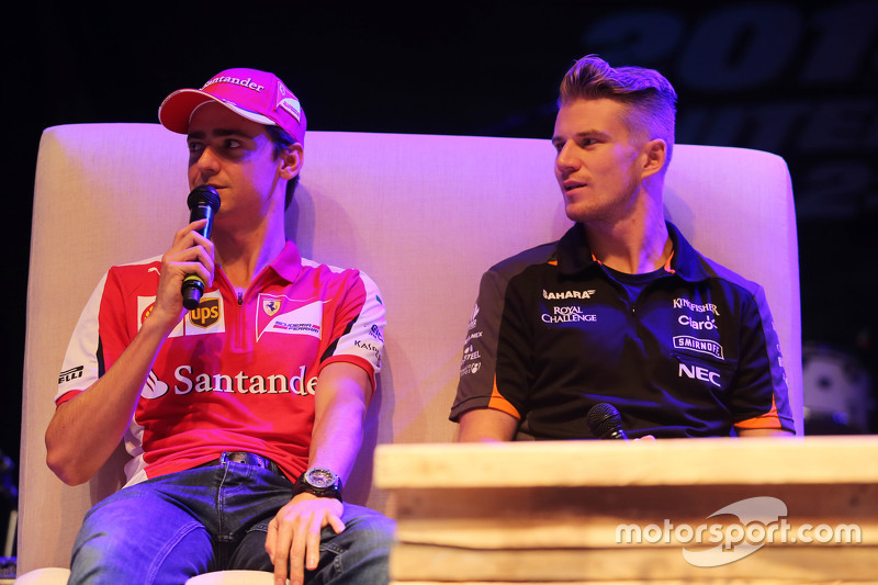 (L to R): Esteban Gutierrez, Ferrari Test and Reserve Driver and Nico Hulkenberg, Sahara Force India F1 at the Fans' Forum