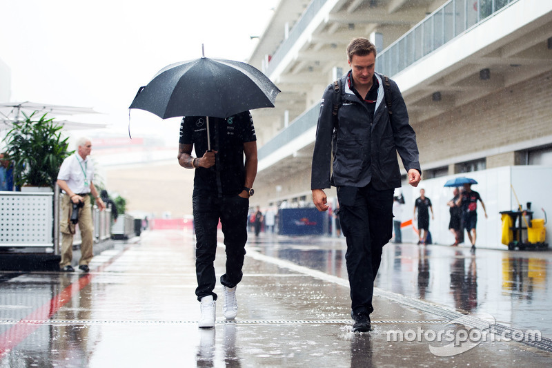 Lewis Hamilton, Mercedes AMG F1 in a wet and rainy paddock