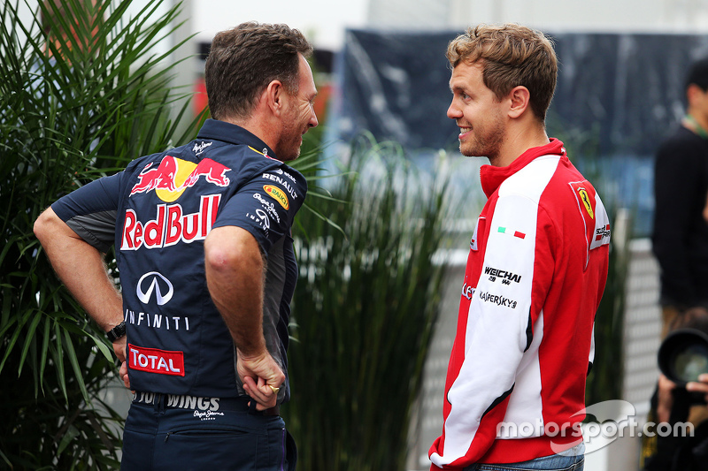 (L to R): Christian Horner, Red Bull Racing Team Principal with Sebastian Vettel, Ferrari