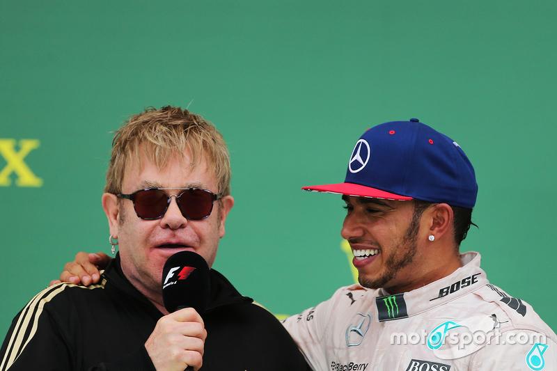 Podium: Sir Elton John with race winner and World Champion Lewis Hamilton, Mercedes AMG F1 on the po