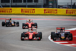 Sebastian Vettel, Ferrari SF15-T and Max Verstappen, Scuderia Toro Rosso STR10 battle for position