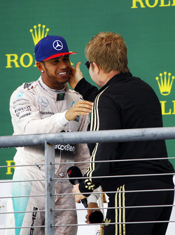 Podium: Race winner and World Champion Lewis Hamilton, Mercedes AMG F1 with Sir Elton John