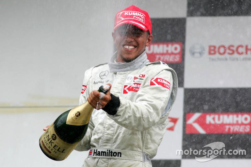 Podium: third place Lewis Hamilton spraying champaign