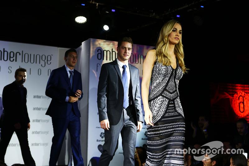Кармен Хорда, Lotus F1 Team гонщик розвитку та Штоффель Вандорн, McLaren Тестовий та резервний гонщик at the Amber Lounge Fashion Show