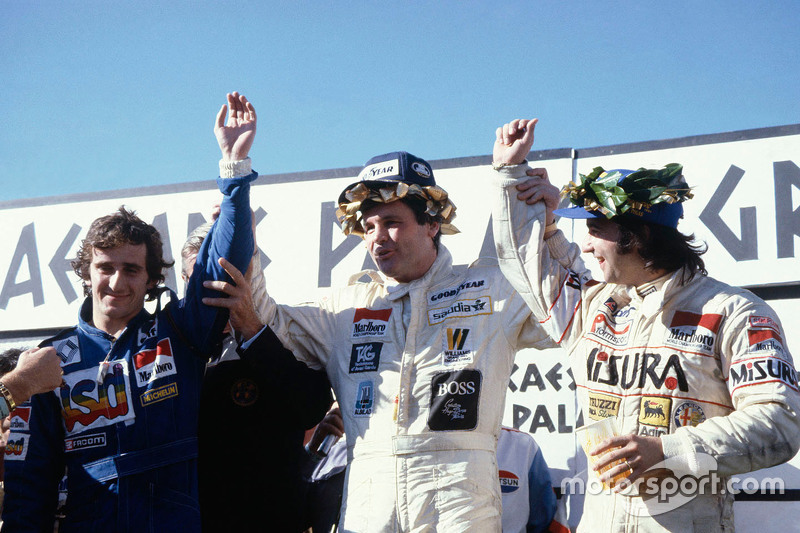 Podium: winner Alan Jones, Williams, second place Alain Prost, third place Bruno Giacomelli