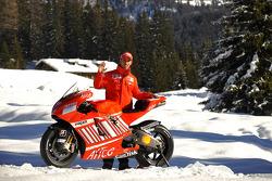 Marco Melandri poses with the Ducati Desmosedici GP8