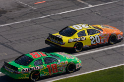 Tony Stewart and Kyle Busch battle on pit road