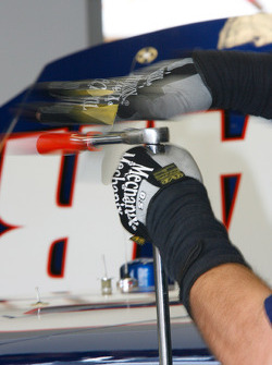 A crew member from Dale Earnhardt Jr.'s #88 National Guard Chevrolet goes to work