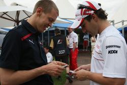 Sebastian Vettel, Scuderia Toro Rosso and Timo Glock, Toyota F1 Team
