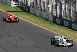 Rubens Barrichello, Honda Racing F1 Team, RA108 and Kimi Raikkonen, Scuderia Ferrari, F2008