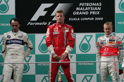 Podium: race winner Kimi Raikkonen, second place Robert Kubica, third place Heikki Kovalainen