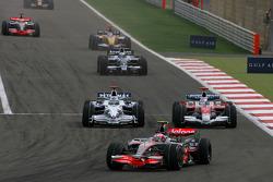Heikki Kovalainen, McLaren Mercedes, MP4-23 and Jarno Trulli, Toyota Racing, TF108