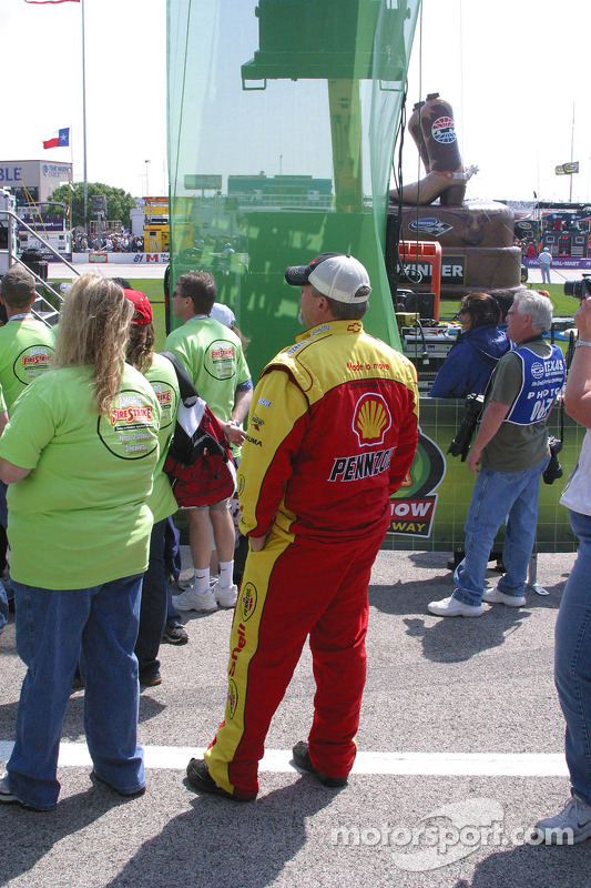A crewman for Kevin Harvick watches The Doobie Brothers
